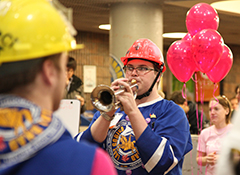 Thomas Santerre, ECE student and Joonyur Bnad Leedur, plays the trumpet at an Engineering event.