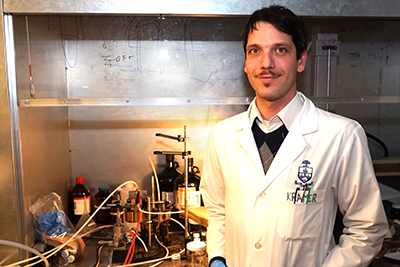 Dr. Illan Kramer and the sprayLD setup he designed to spray solar cells onto flexible surfaces.