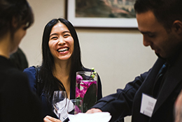 ECE alumni laugh together at the department's Fall Alumni Networking Reception in November 2015.
