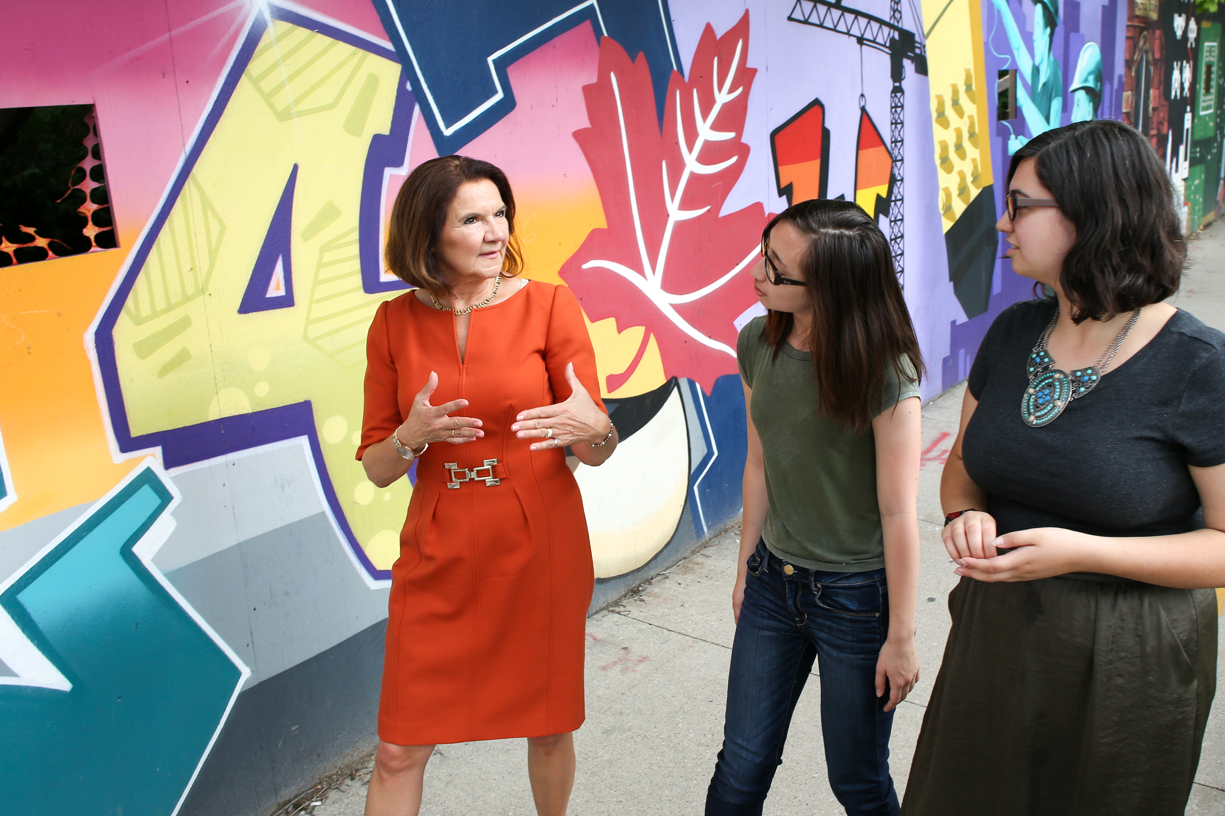 Dean Cristina Amon speaks with students at the site of the new Centre for Engineering Innovation & Entrepreneurship, a vibrant hub for engineering education, innovation and commercialization by entrepreneurship. (Credit: Roberta Baker)