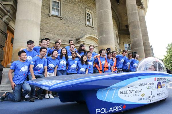 The Blue Sky Solar Racing Team gathers behind Polaris, the vehicle they will enter into the 2017 Bridgestone World Solar Challenge. (Photo: Roberta Baker)