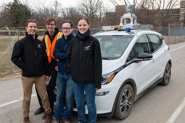 aUToronto team members in front of their autonomous vehicle, Zeus.