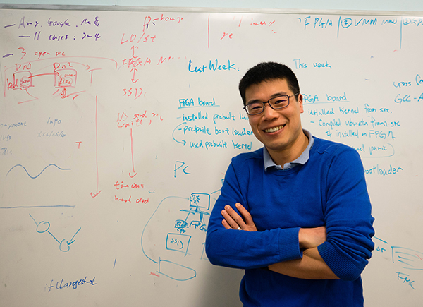 Professor Ding Yuan in front of whiteboard