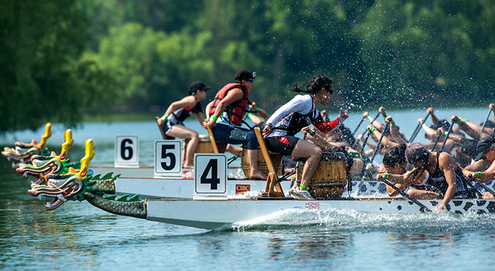 Drummers on the end of a dragon boat